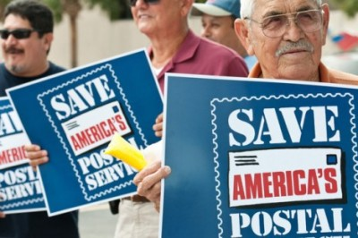 "Opponents of Senate Bill 1789 hold up signs that read ""Save America's Postal Service"" during a protest in Harlingen, Texas. (Jesse Mendoza / Valley Morning Star / Associated Press / April 12, 2012)"