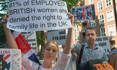 Protests outside the Home Office on the anniversary of the UK's new family migration policy, which prevents UK citizens and refugees earning less than £18,600 from bringing non-EU spouses to live in the UK. Photograph: Peter Marshall/Demotix/Corbis