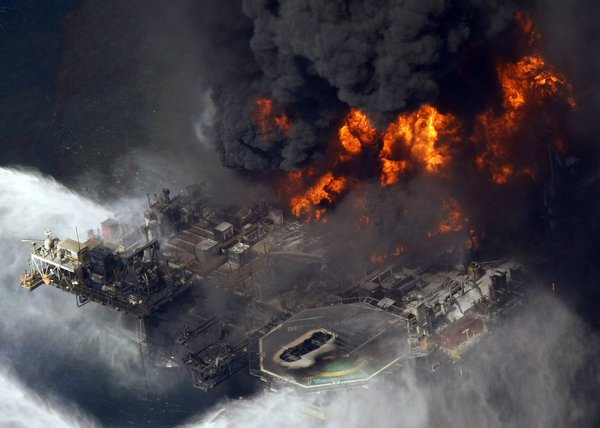 The Deepwater Horizon oil rig burns in the Gulf of Mexico more than 50 miles southeast of Venice on Louisiana's tip. (Gerald Herbert / Associated Press / April 21, 2010)