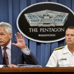 Defense Secretary Chuck Hagel answers a question on the Strategic Choices Management Review during a news conference at the Pentagon, July 31, 2013. Navy Adm. James A. Winnefeld Jr., right, vice chairman of the Joint Chiefs of Staff, joined Hagel for the briefing. DOD photo by Glenn Fawcett