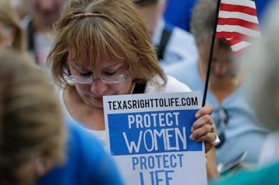 Supporters of an abortion bill pray during an anti-abortion rally at the Texas Capitol, Monday, July 8, 2013, in Austin, Texas. (Photo by Eric Gay/AP)