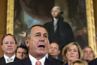 Speaker of the House John Boehner, R-Ohio and Republican members of the House of Representatives rally after passing a bill that would fund the government for three months while crippling the health care law that was the signature accomplishment of President Barack Obama's first term, at the Capitol in Washington, Friday, Sept. 20, 2013.
