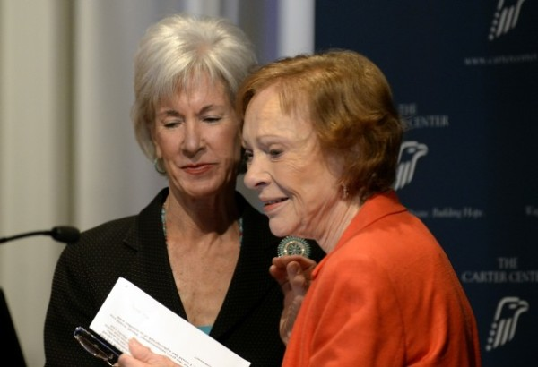 Former First Lady Rosalynn Carter, right, thanks Department of Health and Human Services Secretary Kathleen Sebelius, after Sebelius announced easier access to mental health care during the 29th Annual Mental Health Policy Symposium at the Carter Center on Friday, November 8, 2013.  | David Tulis/Associated Press