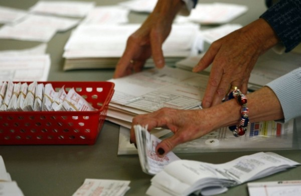 Poll workers reviewing ballots in Charlotte, North Carolina, November 6, 2012. | Reuters/Chris Keane