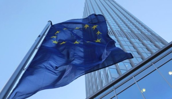 The European Union flag flies in front of the European Central Bank in Frankfurt, Germany. | Photo by Bloomberg