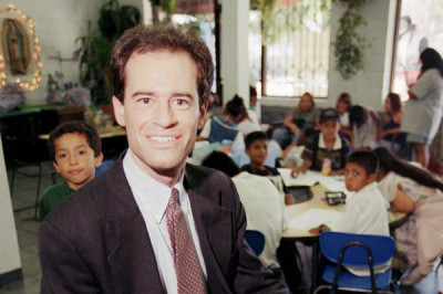 Ron Unz, poses inside the Las Families Del Pueblo child care center in Los Angeles in August 1997. Unz, a Silicon Valley multimillionaire and registered Republican who once ran for governor and, briefly, US Senate, wants state voters to endorse the wage jump that he predicts would nourish the economy and lift low-paid workers from dependency on food stamps and other assistance bankrolled by taxpayers. | Kevork Djansezian/AP