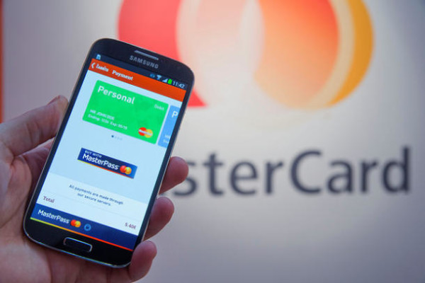 MasterCard and Syniverse partner on new plan to boost credit card security with smartphones. | Credit: MasterCard
