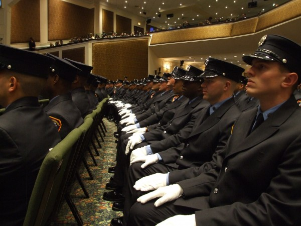 File - Probationary fire fighters sit during a graduation ceremony at the Christian Cultural Center in New York, Dec. 5, 2013. Their graduating class was the most diverse in Fire Department history with 62 percent minorities. | Holly Kellum