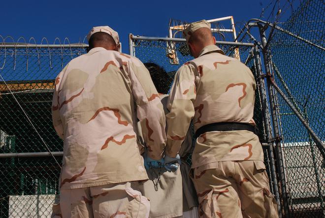 US guards escort a detainee, Guantanamo