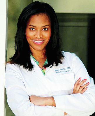 Dr. Misee Harris in lab coat
