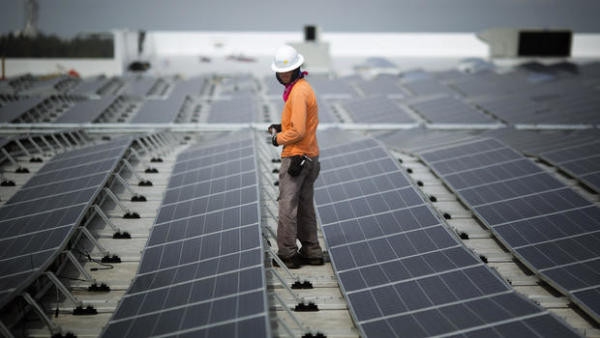 Neil Black works on the installation of South Florida's largest solar panel array atop the future IKEA store in Miami, Wednesday, April 16, 2014. | AP PHOTO/J. PAT CARTER)