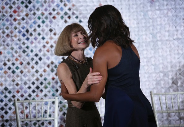 First Lady Michelle Obama hugs Anna Wintour, Editor-in-Chief of Vogue during a session of a Fashion Education Workshop