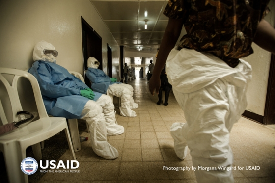 Health workers in personal protective equipment (PPE) wait to enter the hot zone at Island Clinic in Monrovia, Liberia on Sept. 22, 2014. PPE is their primary protection, but it is also the greatest source of stress.