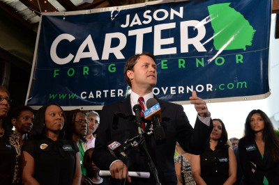 Jason Carter speaks with supporters during his election night party at the 5 Seasons Brewing Company