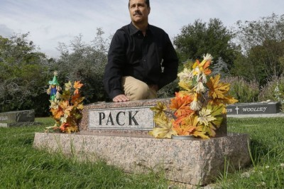 Bob Pack poses at the headstone of his children, Troy, 10 and Alana, 7. in Lafayette, Calif.