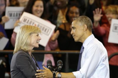 President Barack Obama with Wisconsin Democratic gubernatorial candidate Mary Burke during a rally at the North Division High School