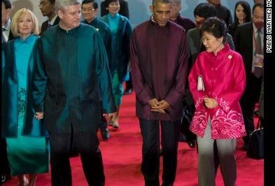 U.S. President Barack Obama, second right, walks with South Korean President Park Geun-hye, right, and Canadian Prime Minister Stephen Harper, second left, and his wife, Laureen, at the APEC Summit Nov. 10, 2014