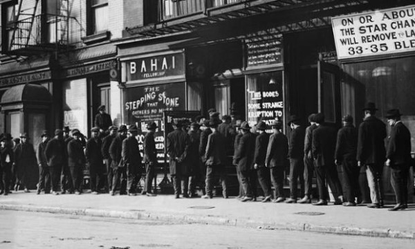 image of unemployed men queue for coffee and bread at a soup kitchen in New York, during the Great Depression.