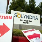 image of auction signs sit in front of Solyndra LLC signage displayed outside the company's headquarters in Fremont, California, during December 2011.