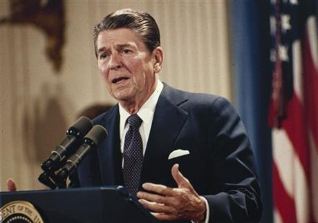 Oct. 19, 1983 file photo, President Ronald Reagan speaks during a news conference at the White House in Washington.