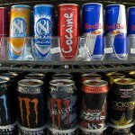 Cans of energy drinks are displayed in a store