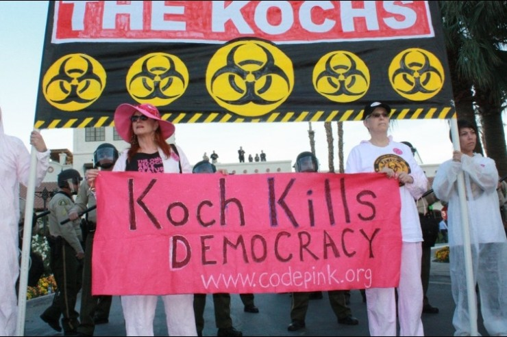 "image of Code Pink protest Koch Brothers, ""Koch Kills Democracy"