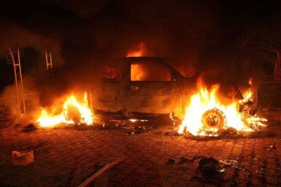 vehicle and the surrounding area are engulfed in flames after it was set on fire inside the US consulate compound in Benghazi