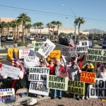 Protesters holding signs criticizing Barack Obama outside his rally for his immigration plan at Del Sol high school in Las Vegas, Nevada on November 21, 2014