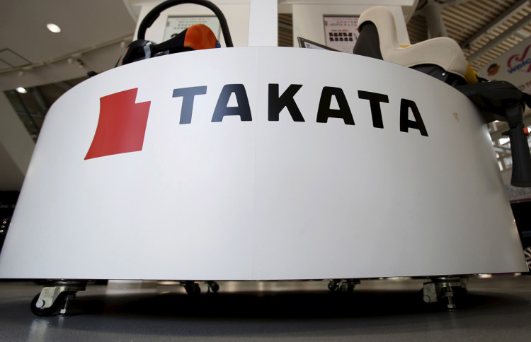 A logo of Takata Corp is seen with its display at a showroom for vehicles in Tokyo, Japan, May 8, 2015.