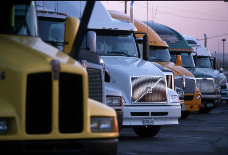 Tractor-trailer rigs are parked at the Petro truck stop May 29, 2000in El Paso, TX. |   Joe Raedle — Getty Images