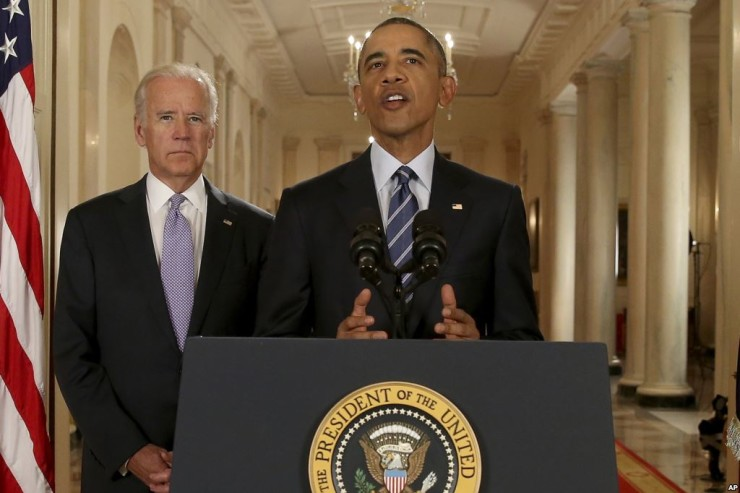 President Barack Obama, standing with Vice President Joe Biden, announces an Iranian nuclear deal