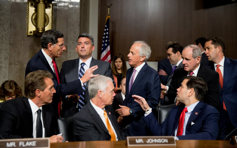 Clockwise from top left, Sen. John Barrasso, R-Wyo., Sen. Cory Gardner, R-Colo., Chairman Sen. Bob Corker, R-Tenn., Sen. James Risch, R-Idaho, Sen. Jeff Flake, R-Ariz., Sen. Ron Johnson, R-Wisc., and Republican presidential candidate, Sen. Marco Rubio, R-Fla., speak together before Secretary of State John Kerry, Secretary of Energy Ernest Moniz, and Secretary of Treasury Jack Lew, arrive to testify at a Senate Foreign Relations Committee hearing on Capitol Hill, in Washington, Thursday, July 23, 2015, to review the Iran nuclear agreement. |  AP/ Andrew Harnik