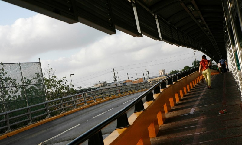 A woman walks towards point of entry of Brownsville, Texas from Matamoros, where the new rail link is located.   Tomas Bravo/Reuters